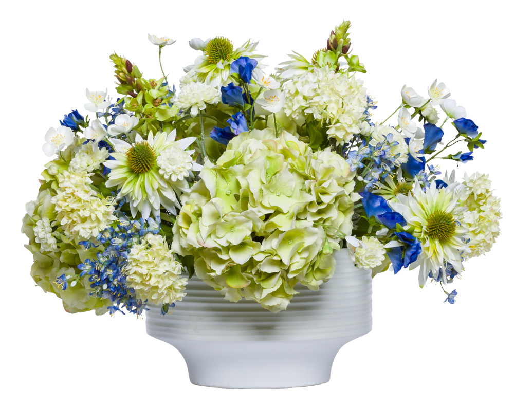 ASSORTED FLOWERS IN WHITE POT